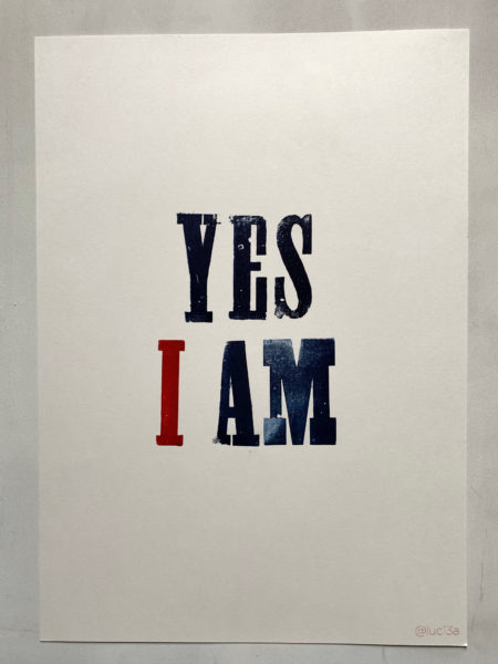 "A poster that has the words ""YES I AM"" printed on it"